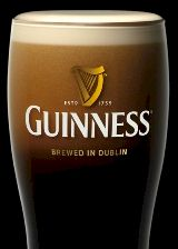 Glass of Guinness with etched harp logo