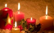 Christmas candles with holly.