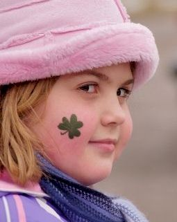 Girl with shamrock plant symbol on her cheek