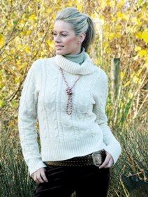 Young blonde model wearing pale cream coloured Aran sweater