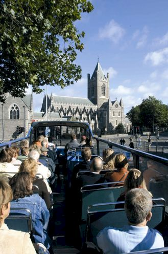 Dublin Sightseeing Tour Bus approaching Christchurch Cathedral.