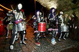 Musical band dressed as skeletons.