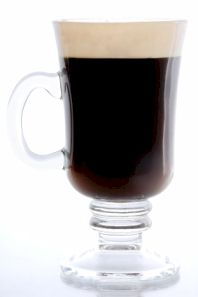 Irish coffee in traditional Irish coffee mug.