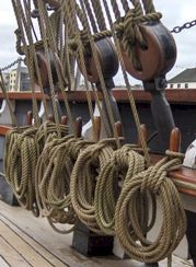 Row of ropes on a replica 19th-century ship.