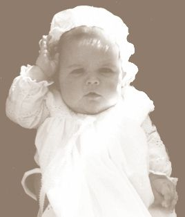 Baby girl, dressed for baptism