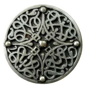 A Celtic brooch.