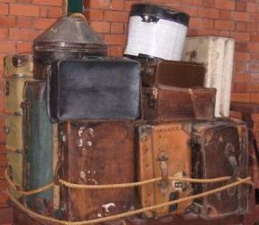 Luggage of Irish immigrants to America, stacked up at port.