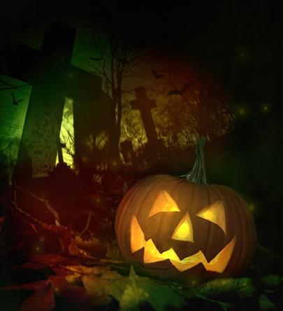 Pumpkin Jack O Lantern in graveyard.