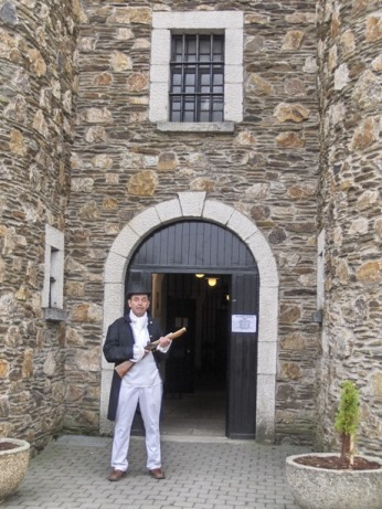 Entrance to the historic Wicklow Gaol, guarded, in character outfit, by the warden carrying a blunderbuss.