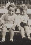 Two 1930s children on bench in Bagenalstow, Co Carlow, Ireland.