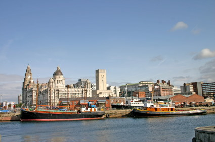 View of Liverpool Docks with river and boats in foreground and the city behind.