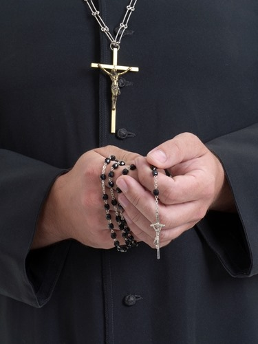 Rosary in RC priest's hands