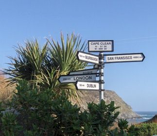 Direction signs pointing to places around the world. Located in Cape Clear, Ireland.
