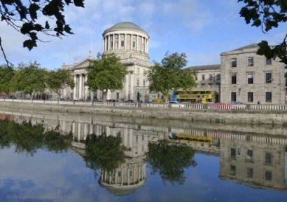 The Four Courts Building, reflecting in the River Liffey, Dublin.