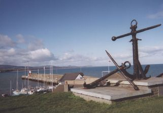 View over Wicklow Harbour, with huge old anchors in the foreground.