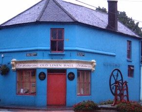 The Old Linen Hall in Clonakilty, Co Cork, with Spinning Wheel outside.