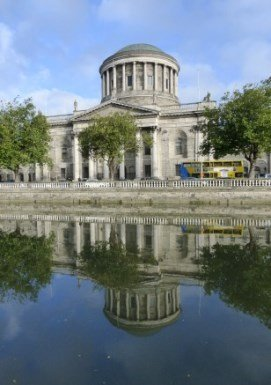 Four Courts building in Dublin, with reflection in River Liffey.