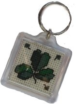 keyring with cross-stitched shamrock within.